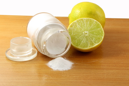 baking soda or baking powder in glass bottle with lemon fruit